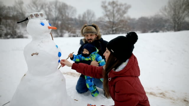 making a snowman with my family - making a snowman stock videos & royalty-free footage