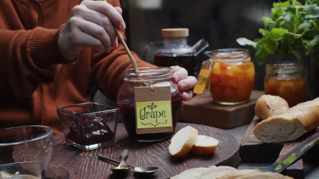 making a toast with homemade jam for breakfast - red grape stock videos & royalty-free footage