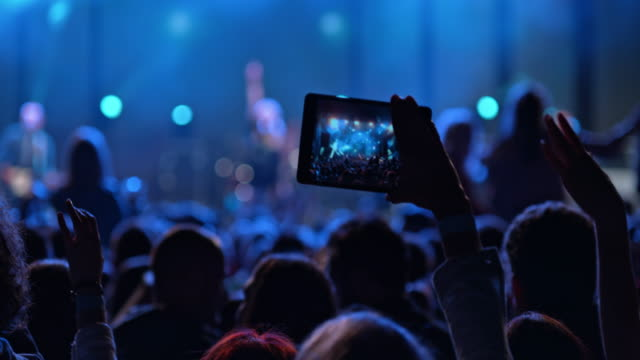 making a video of night concert performance with tablet - filming stock videos & royalty-free footage
