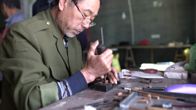making a wooden chinese character - tradition stock videos & royalty-free footage