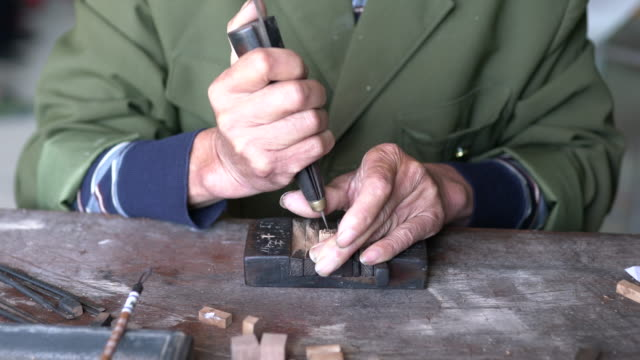 making a wooden chinese character - carving craft product stock videos & royalty-free footage