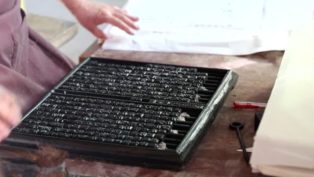vídeos y material grabado en eventos de stock de making a wooden chinese character - máquina impresora