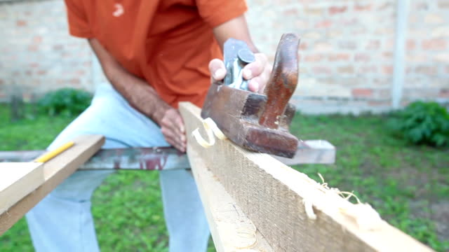 making a wooden fence - wood stain stock videos & royalty-free footage