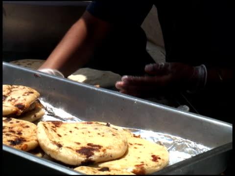 making and selling pupusa, gordita, arepas filled tortillas (latin america) - letterbox format bildbanksvideor och videomaterial från bakom kulisserna