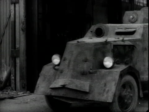 vidéos et rushes de making arms in an underground munitions factory / manufacturing armored cars and airplanes / a nazi seaplane shot down by a young spaniard - bombardement