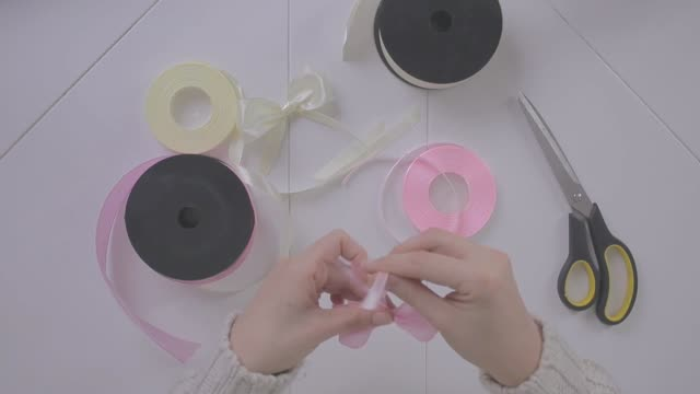 making bows out of ribbons - ribbon sewing item stock videos & royalty-free footage