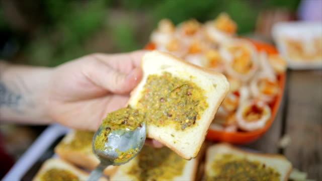 Making bruschetta outdoors for friends