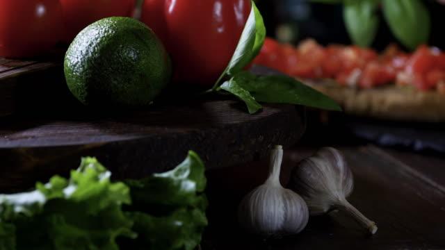 making bruschetta with fresh tomato and avocado - avocado salad stock videos & royalty-free footage