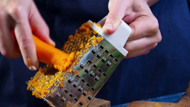 making carrot juice - carrot stock videos and b-roll footage