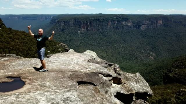 making cartwheel on a mountain top. aerial view - cartwheel stock videos & royalty-free footage