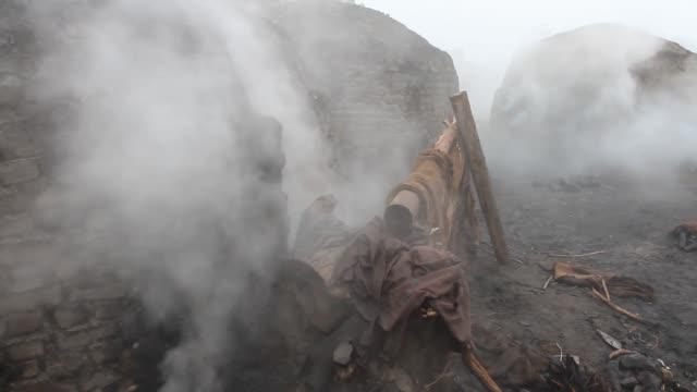 making charcoal (wood coal) - punjab pakistan stock videos and b-roll footage
