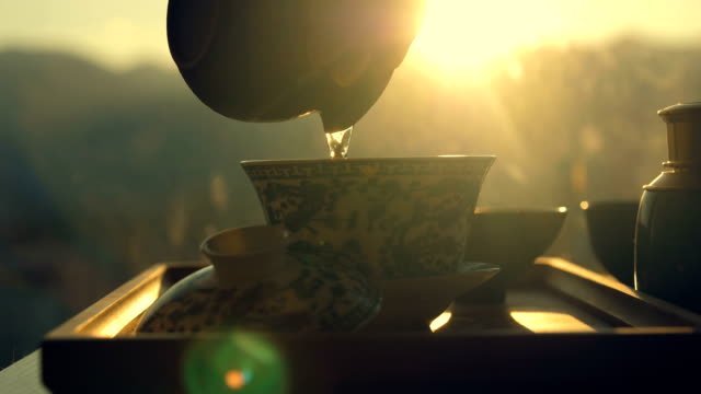 making china tea,pouring water into tea cup - teapot stock videos & royalty-free footage