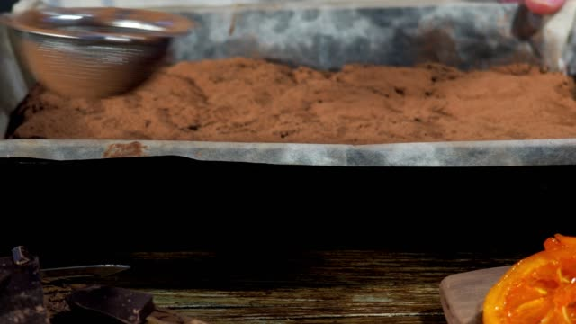 making chocolate cake at home - cocoa powder stock videos & royalty-free footage