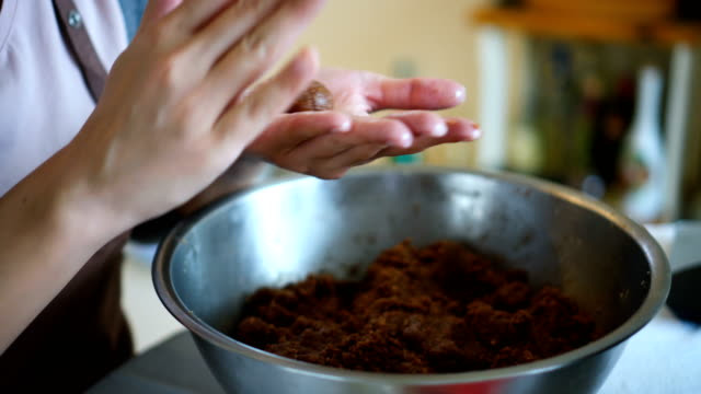 making chocolate cookie balls - baking stock videos & royalty-free footage