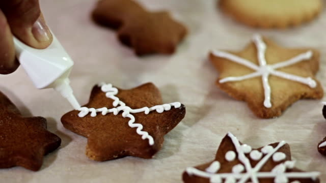 making christmas cookies - icing stock videos and b-roll footage