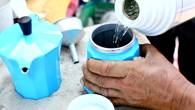 Making coffee from moka pot.