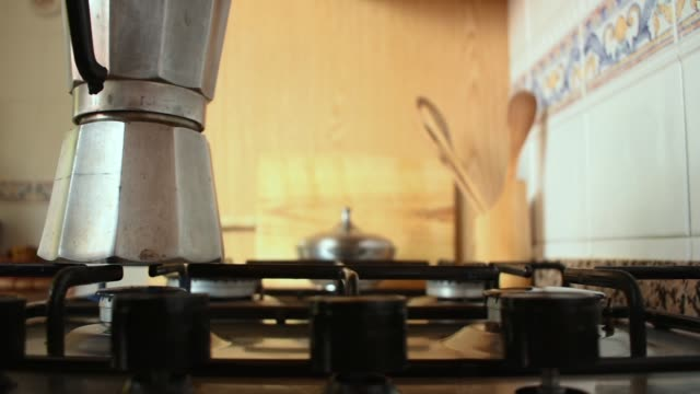 making coffee on the gas stove. moving video shot - coffee pot stock videos & royalty-free footage