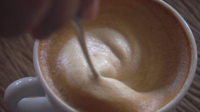 making coffee slow motion - frothy drink stock videos & royalty-free footage