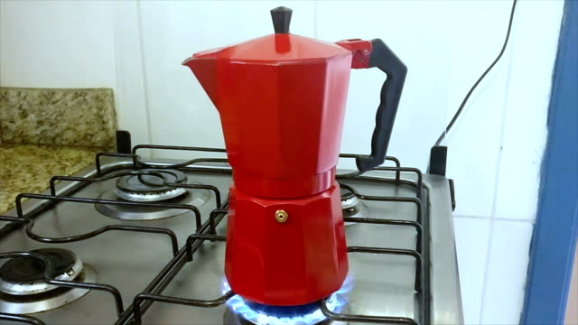 making coffee with italian house coffeepot - mocha stock videos and b-roll footage