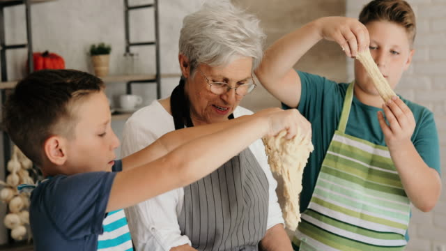 making cookies with grandma is always a great fun - grandson stock videos & royalty-free footage
