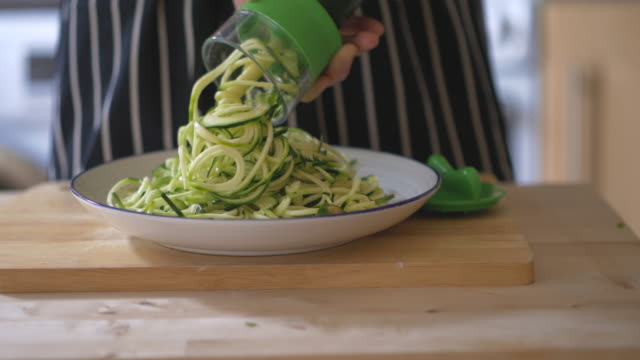 making courgettes noodles - courgette stock videos and b-roll footage
