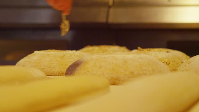 Making cuts on the bread dough in San Francisco