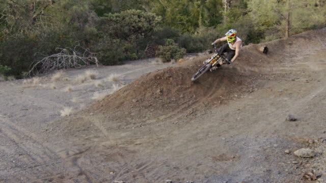 making dirt fly with mountain bike - fatcamera stock videos and b-roll footage
