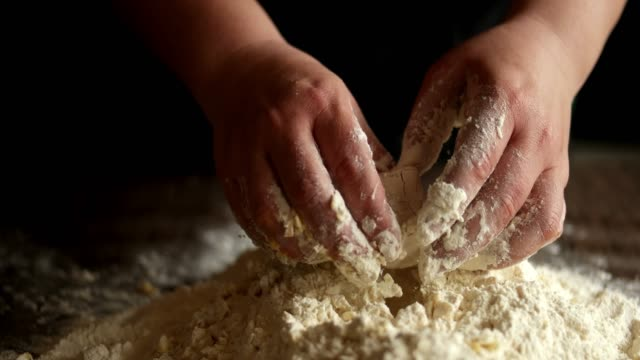 making dough by female hands on wooden table background - mixing stock videos & royalty-free footage
