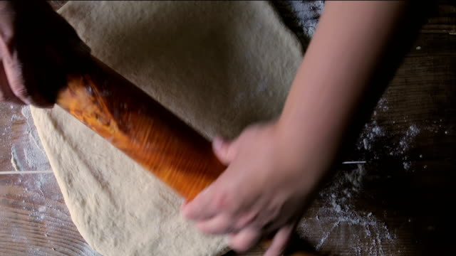 making dough by female hands on wooden table background - rolling pin stock videos & royalty-free footage