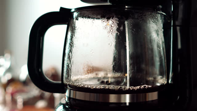 making drip coffee with filter coffee machine - cofffee dripping with sound - audio available stock videos & royalty-free footage