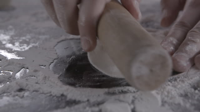 making dumpling dough by rolling pin - rolling pin stock videos & royalty-free footage