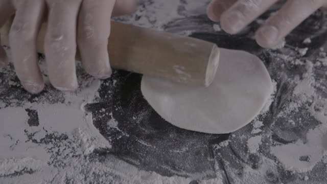 making dumpling dough into circle shape by rolling pin - rolling pin stock videos & royalty-free footage