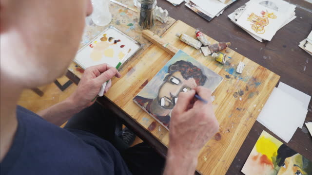 making final adjustments to the painting. - painter artist stock videos and b-roll footage