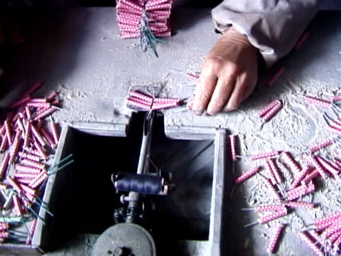 making fireworks tying packs of firecrackers together - firework explosive material stock videos & royalty-free footage