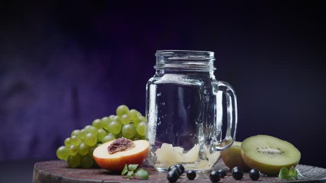 making fruit salad in mason jar - fruit salad stock videos & royalty-free footage