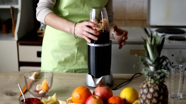 making fruit smoothie - electric juicer stock videos & royalty-free footage