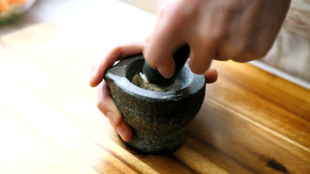 making garlic paste using mortar and pestle - garlic stock videos & royalty-free footage