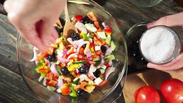 making greek salad - adding salt stock videos and b-roll footage