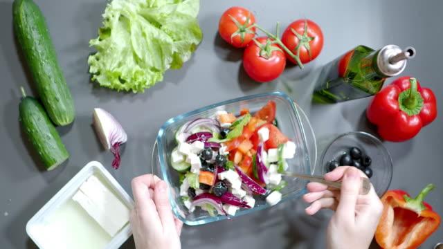 making greek salad - feta stock videos & royalty-free footage