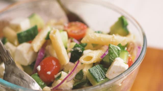 making greek style pasta salad - feta stock videos & royalty-free footage