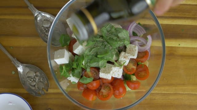 making greek style pasta salad - mediterranean culture stock videos & royalty-free footage