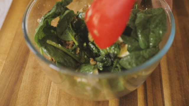 making green lentil, spinach, and feta cheese salad - feta stock videos & royalty-free footage