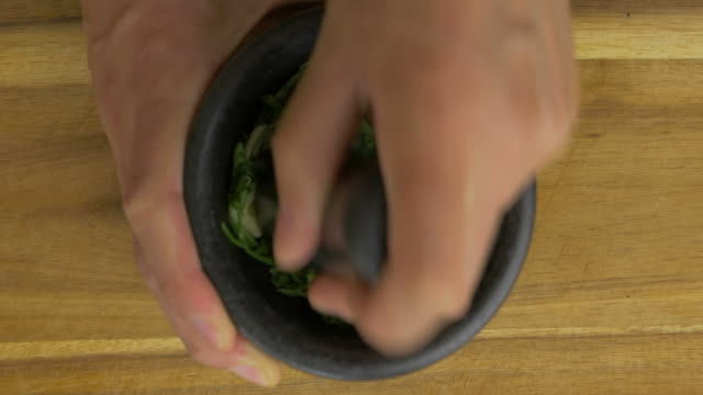 making green pesto sauce - herb stock videos & royalty-free footage