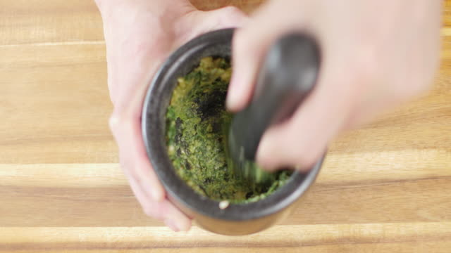 making green pesto sauce - basil stock videos & royalty-free footage