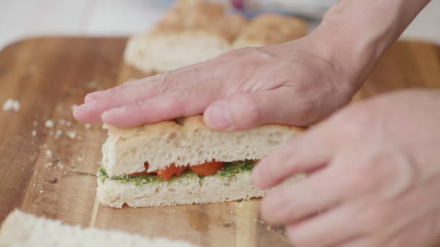making grilled vegetable focaccia sandwich - sandwich stock videos & royalty-free footage