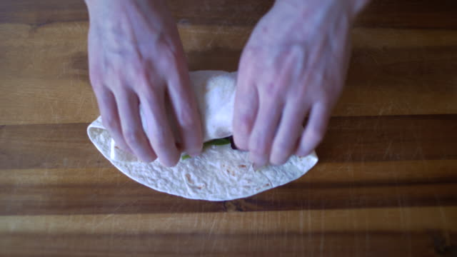 making grilled vegetable wrap sandwich