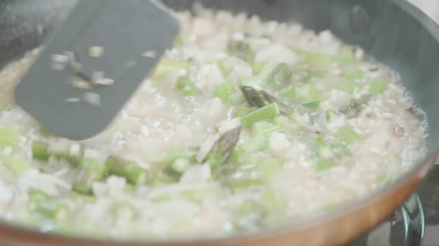 making herb vegetarian asparagus  risotto - risotto stock videos & royalty-free footage