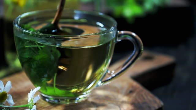 making herbal tea - spoon stock videos & royalty-free footage
