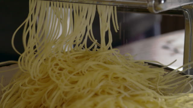 cu ds making homemade pasta - pasta machine stock videos and b-roll footage