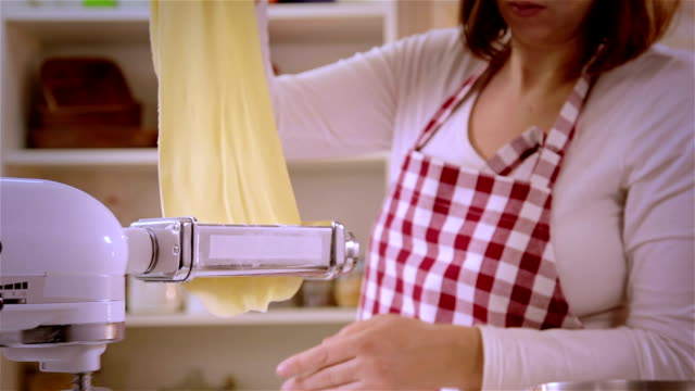 making homemade pasta - pasta machine stock videos and b-roll footage